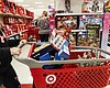 Shoppers browse the aisles during a Black Frida...