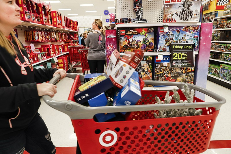 Shoppers browse the aisles during a Black Friday sale at a Target store, Frid...