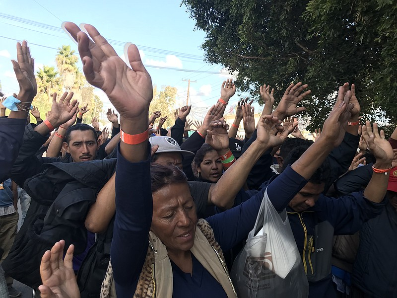 Central Americans participate in street mass in Tijuana, Nov. 23, 2018.