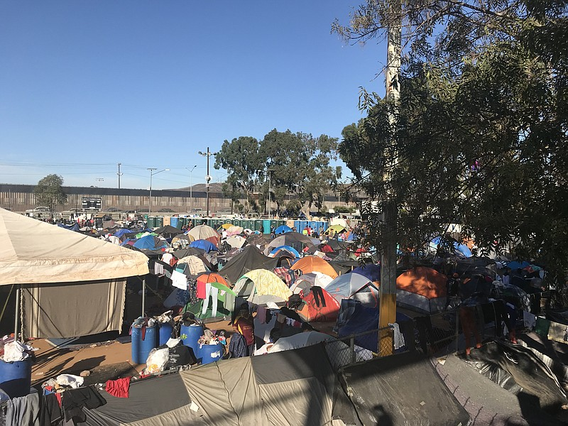 Tents are lined up in sports complex turned shelter in Tijuana by the border ...