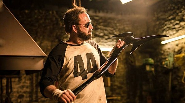 Nicolas Cage forges something akin to an Orc sword in the...