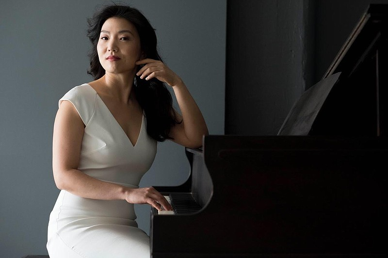 Classical pianist Jeeyoon Kim sitting by a piano in an undated photo.