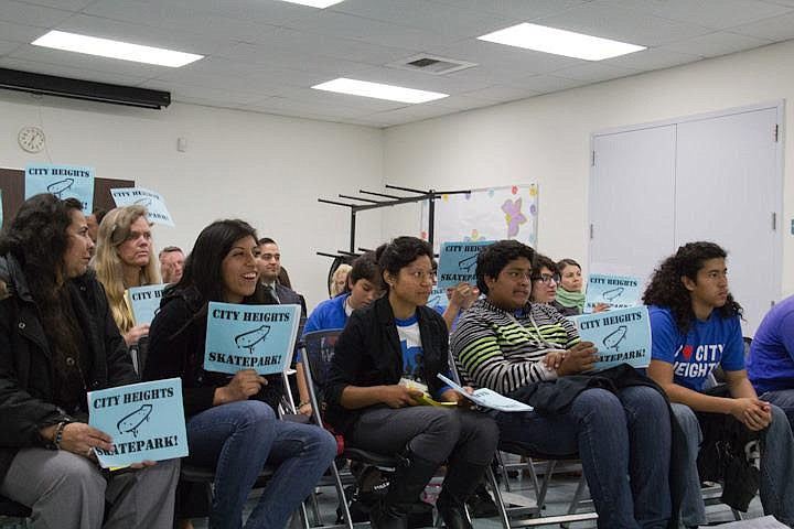 Rosa Olascoaga sits second from left among a crowd of youth advocates and hol...