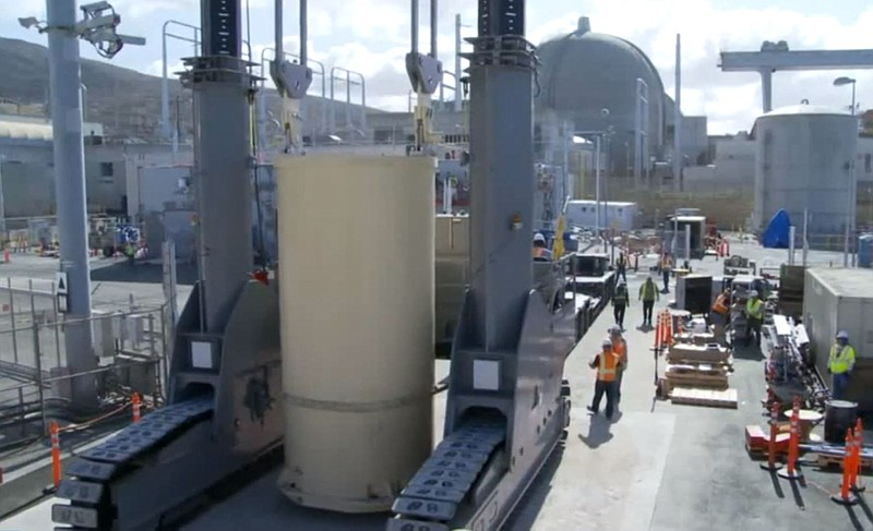 Radioactive spent fuel rods in giant canisters being transferred from spent f...