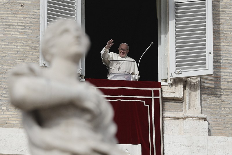 Pope Francis waves to faithful during the Angelus noon prayer in St. Peter's ...