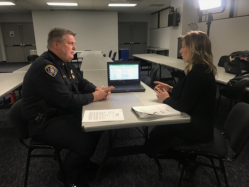 San Diego Police Lt. Jeff Jordon reviews stop data on a laptop with KPBS Repo...