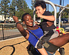 Aleah Jenkins rides a swing with her son in thi...