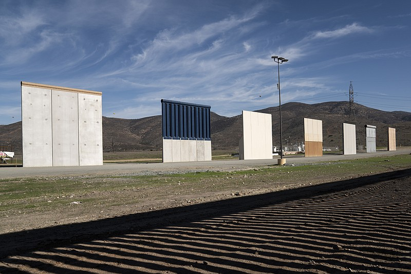 Border wall prototypes stand in San Diego near the Mexico U.S. border, seen f...