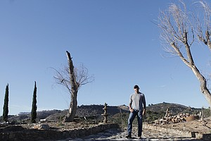 Photo for Property Owners, Volunteers Start Cleaning Up Destruction Left By HiCaliber H...
