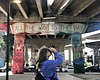 Erica Miller takes a photo in Chicano Park, Nov...