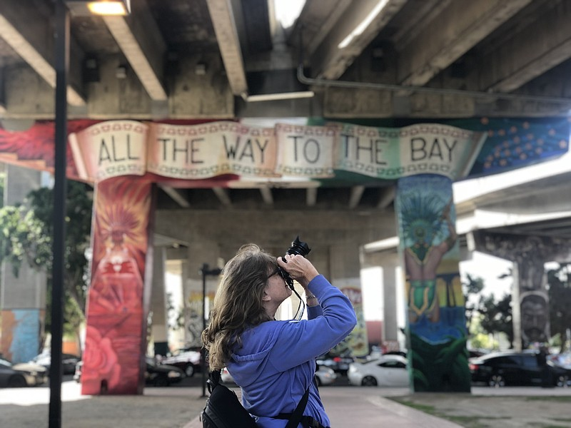Erica Miller takes a photo in Chicano Park, Nov. 8, 2018.