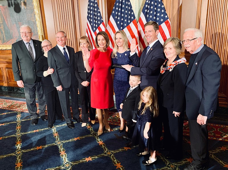 Congressman Mike Levin poses for a photo with his family and Democratic House...