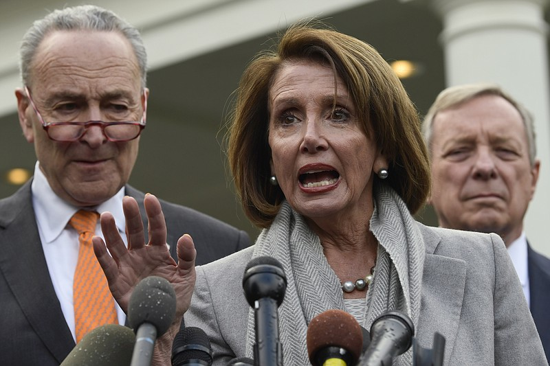 House Speaker Nancy Pelosi of Calif., center, speaks as she stands next to Se...