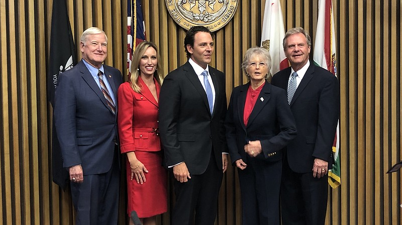 The San Diego County Supervisors pose for a photo after the swearing in new s...