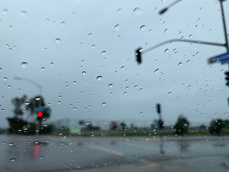Rain from a winter storm on a car windshield in San Diego, Jan. 14, 2019.