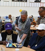 General Manager Tom Karlo volunteering at the Gary and Mary West Senior Wellness Center.
