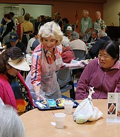 Producers Club member, Donna Carr, volunteering at the Gary and Mary West Senior Wellness Center.