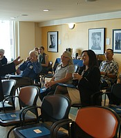 President and CEO of Serving Seniors, Paul Downey, giving a presentation to KPBS staff and Producers Club members.