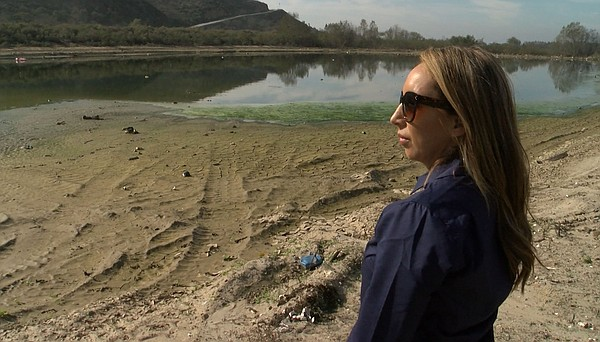 Paloma Aguirre surveys the catch basin in Goat Canyon nea...
