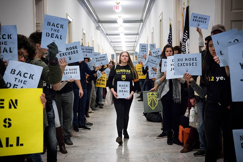 Young activists with the Sunrise Movement fill the halls of Congress to lobby...