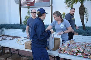 Feeding San Diego Distributes Food To Coast Guard Familie...