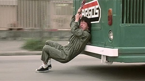 Jackie Chan doing one of his insane stunts in
