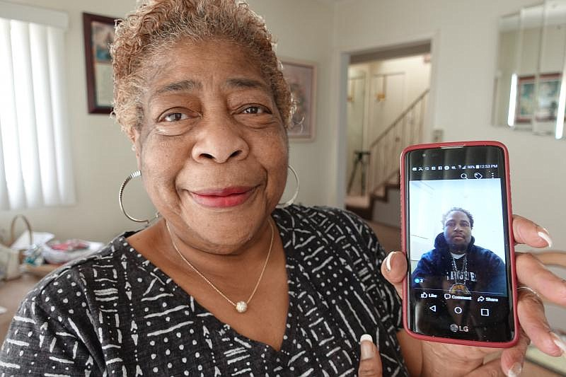 Charlotte Blackwell is pictured with a photo of her son, Air Force veteran Je...