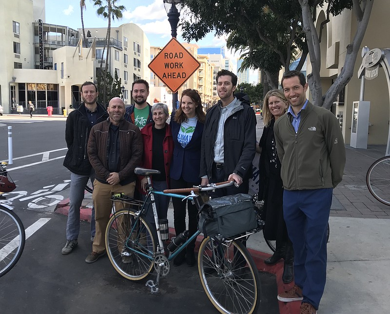 San Diego County Bicycle Coalition Executive Director Andy Hanshaw, second fr...