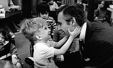 Fred Rogers meets with a disabled boy in the fi...