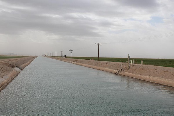 An irrigation canal outside Poston, Arizona carries water...