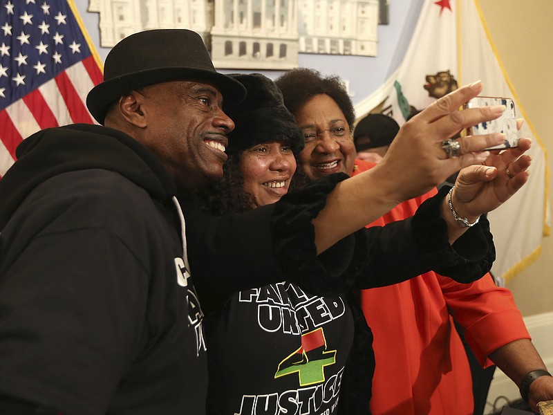 Assemblywoman Shirley Weber, D-San Diego, right, poses for a selfie with Ceph...
