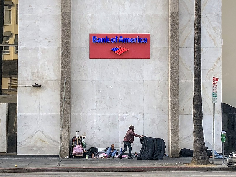Homeless people in front of a Bank of America building on Sunset Boulevard in...