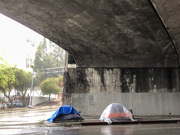 Tents erected beneath the Hollywood Freeway during a rain...