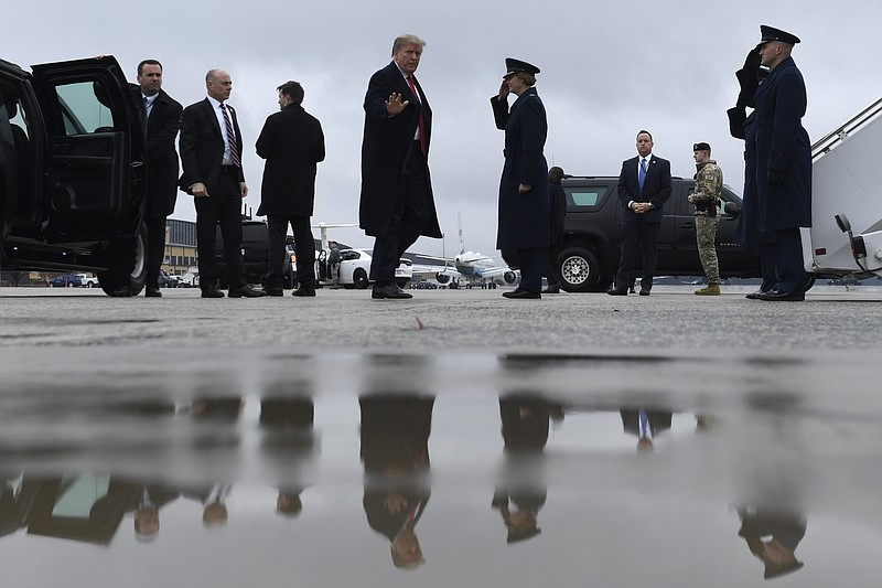 President Donald Trump arrive to board Air Force One at Andrews Air Force Bas...