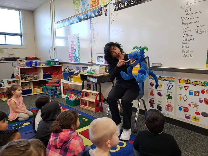 Dental hygienist Deborah Delfino shows a group of preschoolers in Lathrop, Ca...