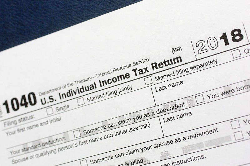 File photo shows a portion of the 1040 U.S. Individual Income Tax Return form...