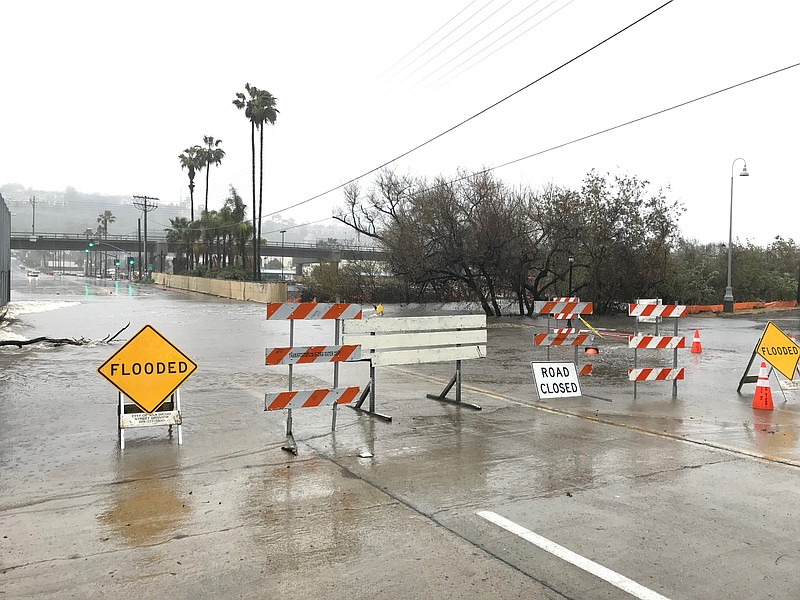 Traffic signs placed on flooded roads in Mission Valley during a winter storm...