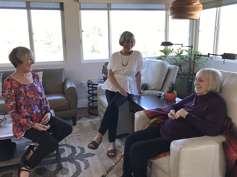 One-hundred-year-old Ginny Davenport enjoys a chat with her daughters Kelly D...