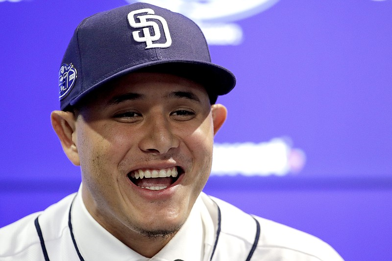 Manny Machado talks to the media during a news conference at San Diego Padres...