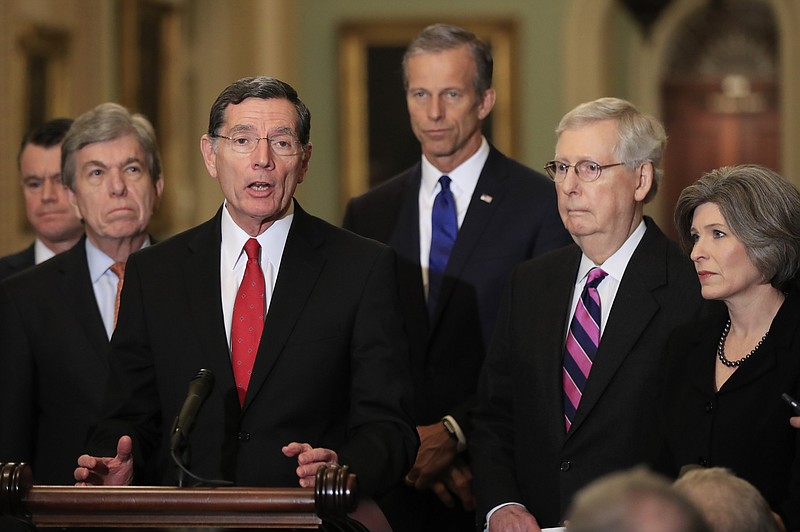 Sen. John Barrasso, R-Wyo., with, from left, Sens. Todd Young, R-In., Roy Blu...
