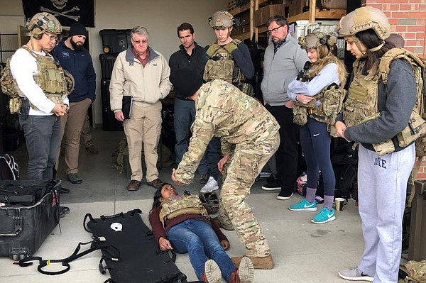 Using a student as a simulated casualty, an Army medic at...