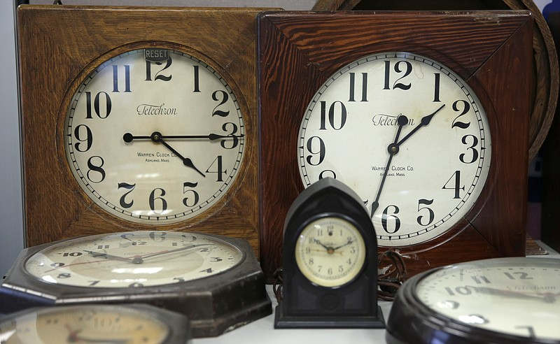 A collection of antique clocks are displayed in the lobby at the Electric Tim...