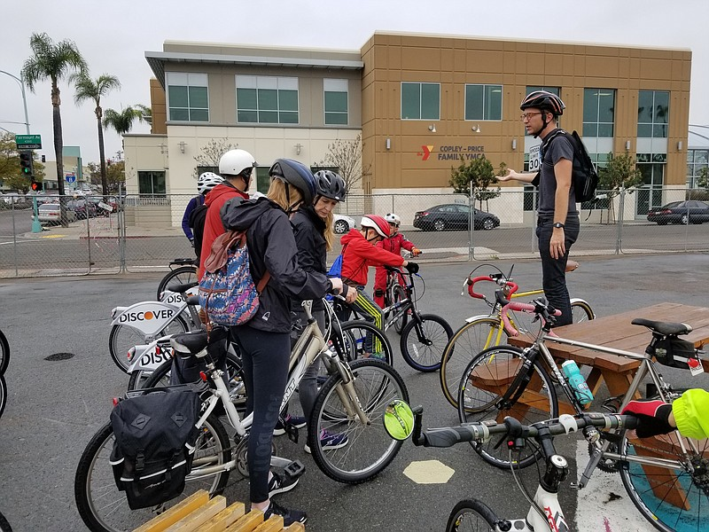 Instructor Kevin Baross leads a bike safety course as students stand mounted ...