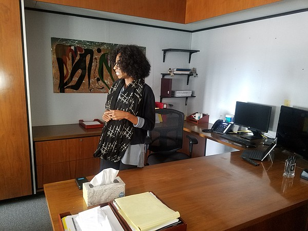 Councilwoman Monica Montgomery stands in her new office i...