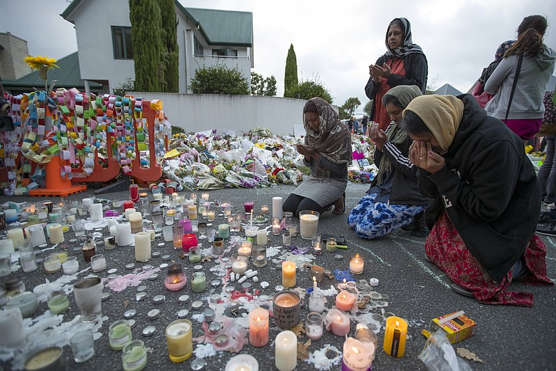 People mourn at a makeshift memorial site near the Al Noor mosque in Christch...
