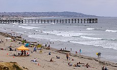 People enjoying a day at Pacific Beach in San D...