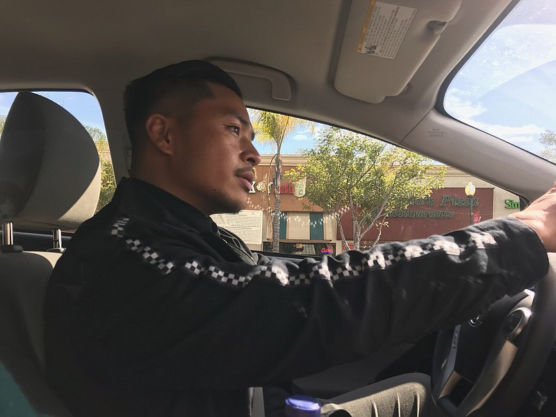 Homeless outreach specialist Jessie Angeles Jr. drives his work vehicle aroun...