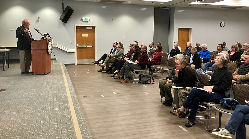 People at the Carlsbad Senior Center hear about the feasibility of having a c...