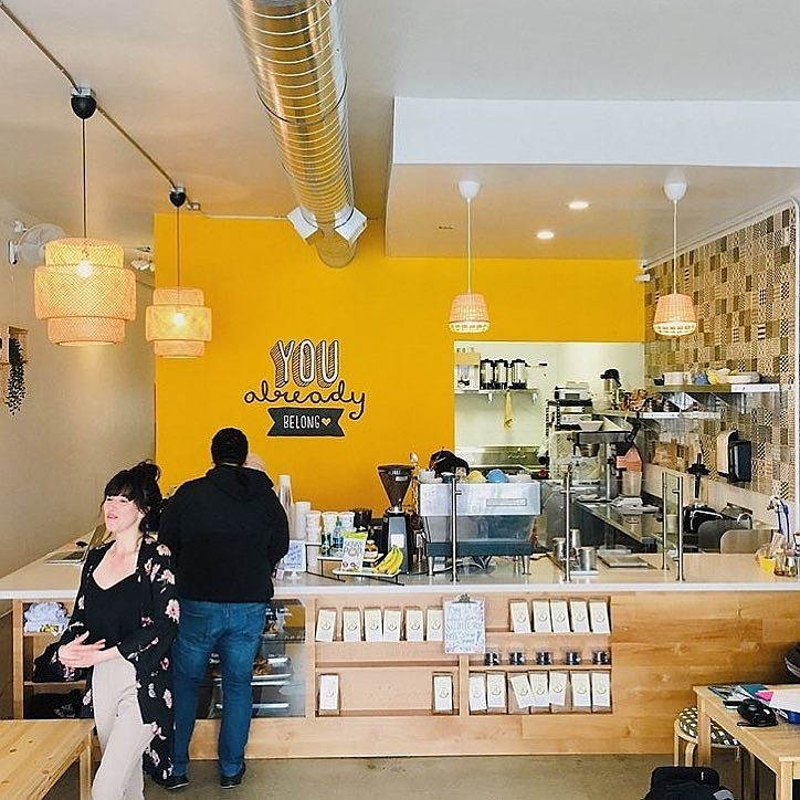 City Heights Coffee House barista serves customers on March 15, 2019.