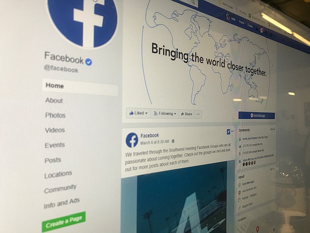 The Facebook website appears on a computer screen, March 28, 2019